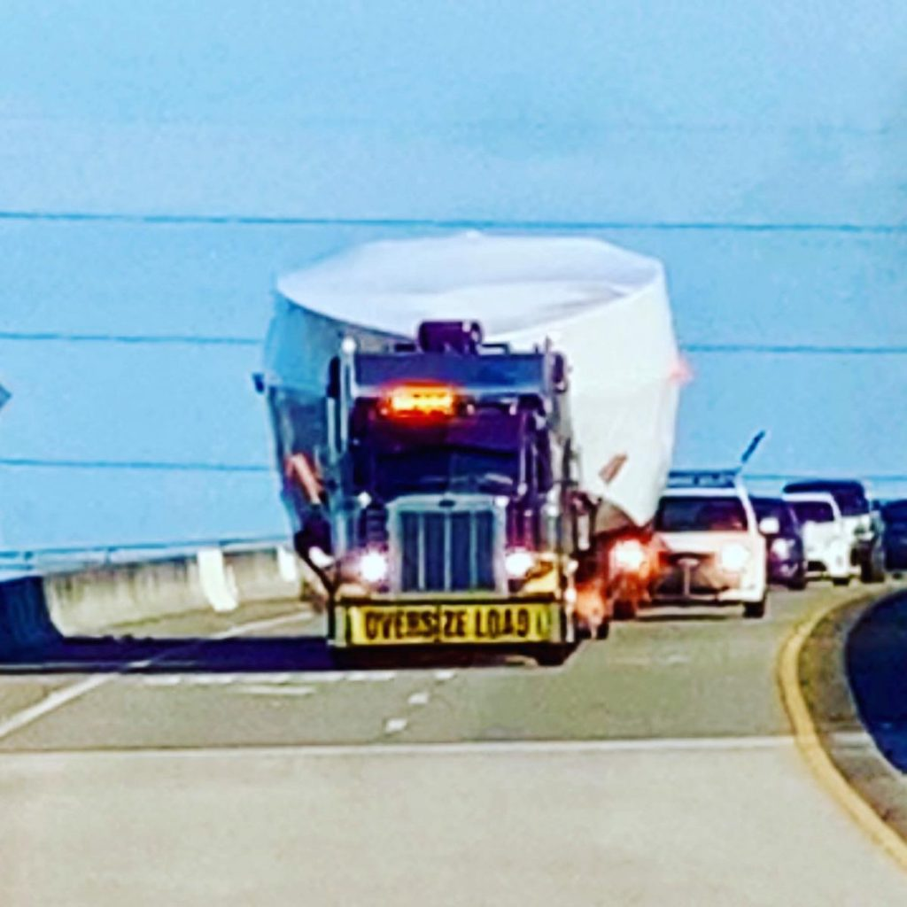 boat being hauled by semi-truck